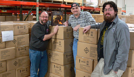 WFRP development team surrounded by boxes